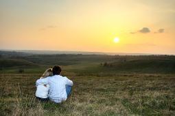 Loving couple watching the sunset