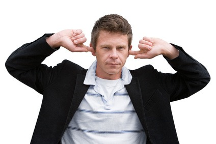 Man with fingers in his ears
