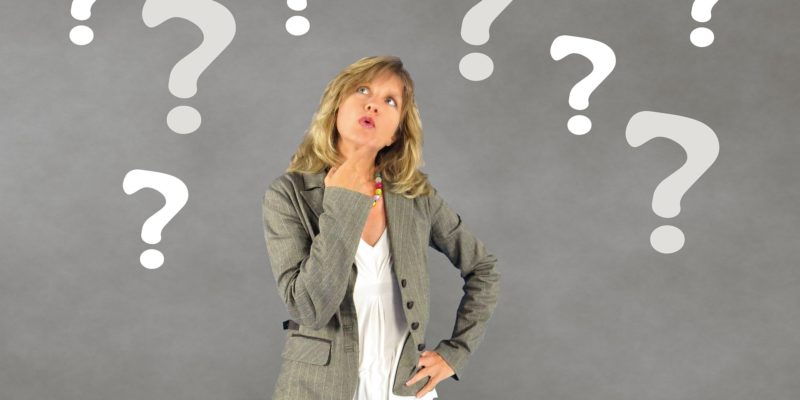 Image of a woman looking up thinking about questions